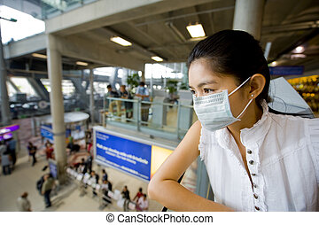 with flu mask at the airport - asian woman at the...
