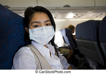 woman with protective mask in a plane - woman with...