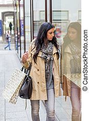 while shopping woman - a young woman einkausbummel. shopping...