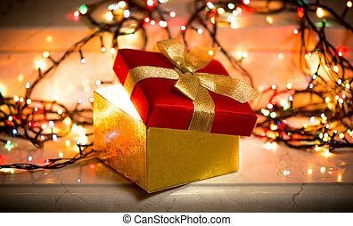open gift box with light coming out of it - Closeup photo of...