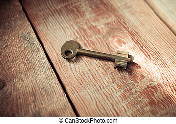 Rusty Old Skeleton Key on Dark Rustic Barnwood With Window...