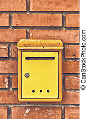 Old obsolete Post Mail Box on brick wall