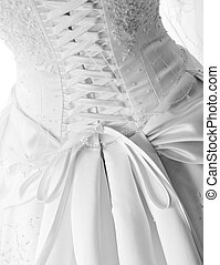 Black and White image of laces on back of wedding gown -...