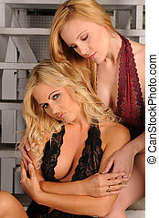 Blondes - Two beautiful blondes standing on an industrial...