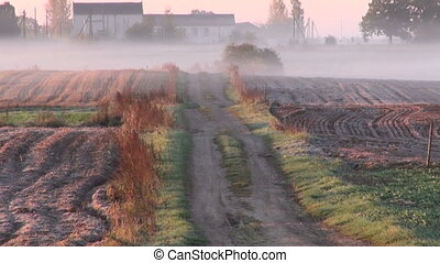 farm field and road in autumn frost - morning rural farm...