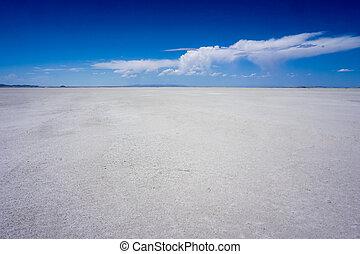bonneville salt flats - The salt flats with a blue sky and a...