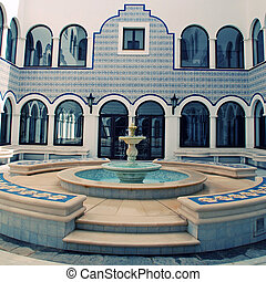 marble fountain in arabic style patio(Morocco) - view of...