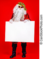 jamaica xmas - Casual Santa Claus hippie holds white board...
