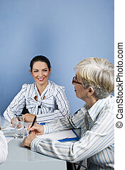 Young and senior business woman conversation - Two...