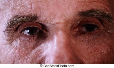 an elderly mans eyes, close-up