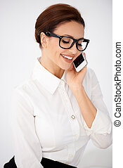 Businesswoman in glasses chatting on a mobile - Attractive...