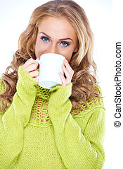 Blue eyed woman enjoying a mug of coffee - Blue eyed woman...
