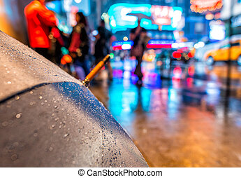 Open umbrella on a rainy night in Times Square - New York City