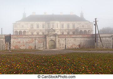 Ancient castle in the morning fog Autumn season