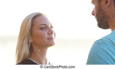 Couple in backit sun - Woman and man kissing against setting...