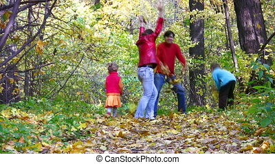family of four throw leaves in wood - Family of four throw...