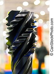 power drill bit closeup over colorful background