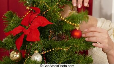 Woman decorate her home for christm