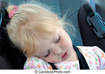 little girl sleeping in car seat - Little Caucasian girl...
