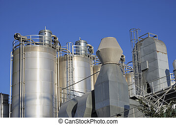 Factory - Industrial site with big storage tanks....