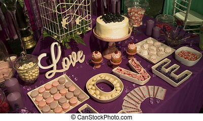 View of dessert wedding table with candles