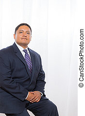 Professional Hispanic Male In Suit With Confident Expression...
