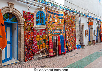 Colorful oriental carpets for sale in the medina of...