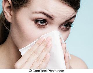 Flu allergy. Sick girl sneezing in tissue. Health
