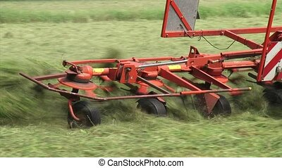 hay field - close up rake shakes out and loosens hay so as...