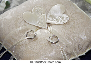 Wedding rings - Two wedding rings on a beige pillow