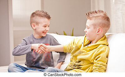 two babies shaking their hands as they were businessmen