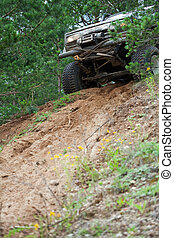 Off road truck in trial competition - Closeup of 4x4 truck...