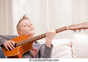 little boy is very good at playing guitar - this little boy...