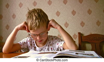 child read book with old glasses