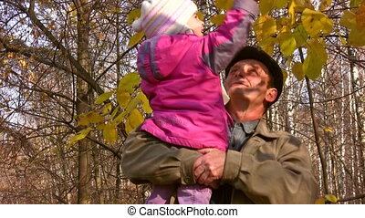 senior with child and autumn leaves - Senior with child and...