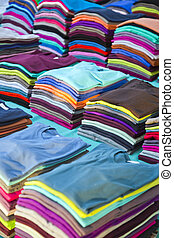 Stack of colorful tshirts - Stack of colorful and new folded...