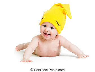 smiling baby weared funny hat lying on stomach