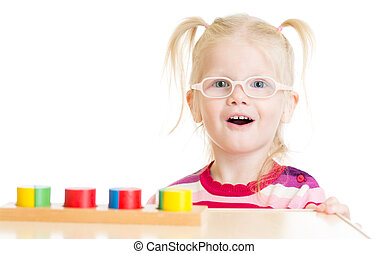 Funny child in eyeglases playing logical game isolated - Kid...