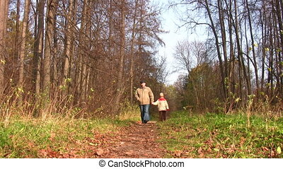 senior with child walking in park