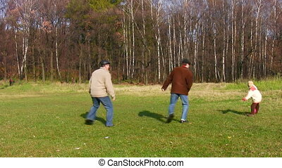 son, father and grandfather play football in park