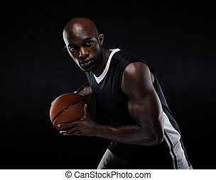 Fit young male athlete playing basketball - Portrait of fit...