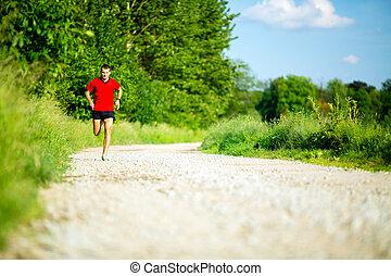 Man running jogging on country road - Man runner running on...