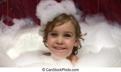 little girl in bath with foam on head - Little girl in bath...