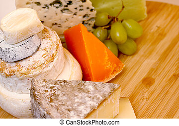 Various types of cheese composition on wooden board