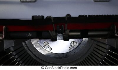 TYPEWRITER with written old style in the paper