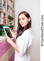 Pharmacist with digital tablet in hands