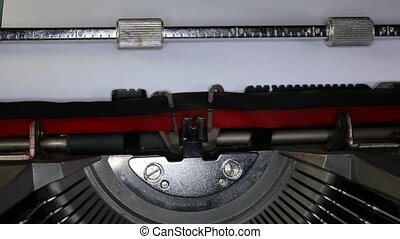 TYPEWRITER with written abcdefg in the paper