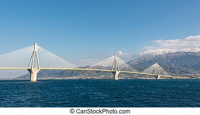 Suspension bridge across a sea - Suspension bridge crossing...