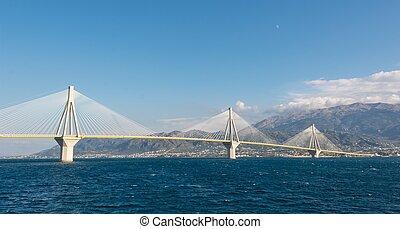 Suspension bridge across a sea - Suspension bridge crossing...