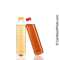 Bottles full of vinegar. Isolated on a white background.